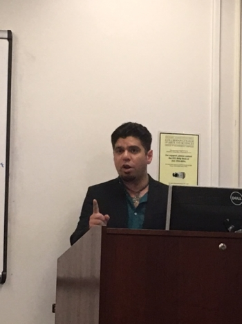 "Arsia Rozegar presenting his research on ""The Shahnameh in Pop Culture and Media."